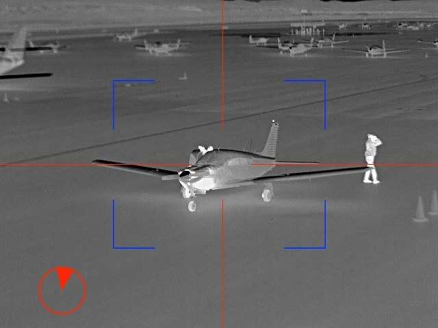 Image from mobile ptz of airport security showing thermal image of people and airplanes